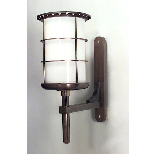 French 1940s steel and brass cylindrical shaped bracket lantern with white liner attributed to Gilbert Poillerat. The...