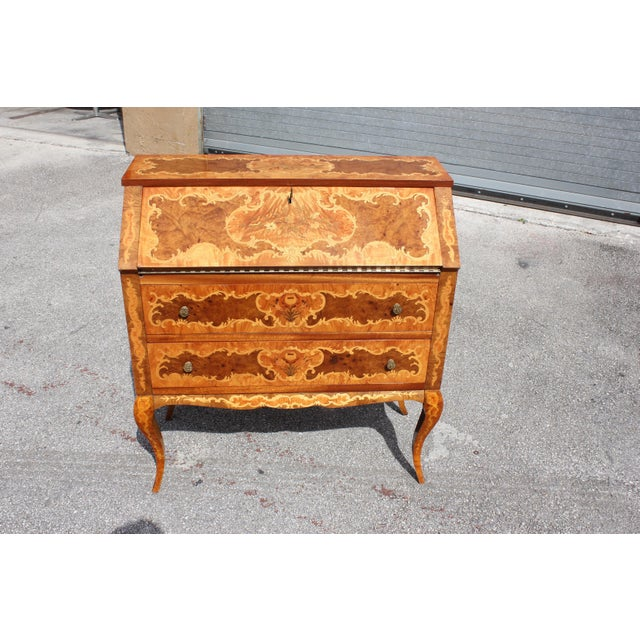 Beautiful Italian Louis XV style luxury chest of drawers with secretary desks circa 1950s. Important elegant chest with...
