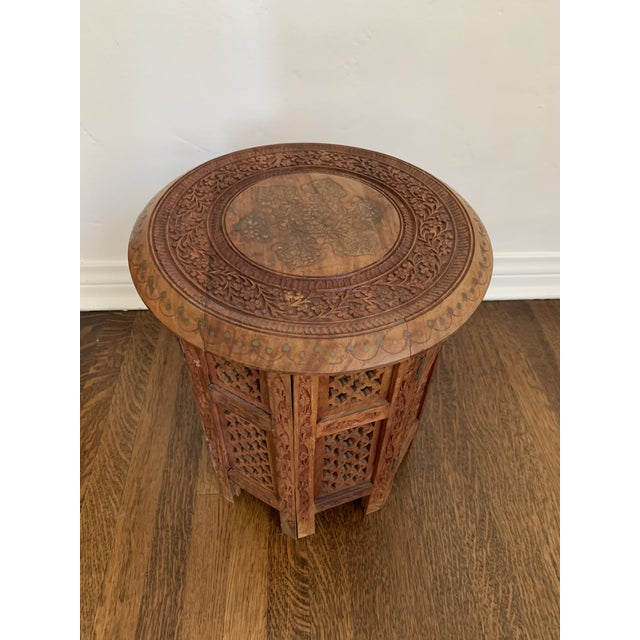 Beautiful Moorish carved wood octagon side table. Intricate design with ornate brass inlay on top. Base disconnects from...