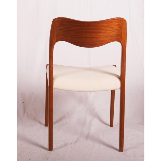 Dining chairs is made of solid teak. They were designed in 1951 by Niels Otto Møller and produced by JL Møllers...
