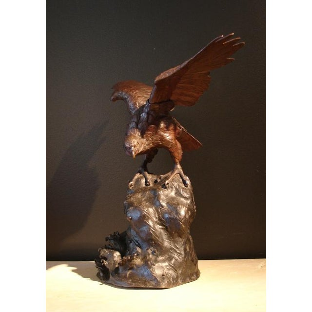 A wonderfully rendered bronze sculpture of an osprey or sea hawk. Perched on a rocky outcropping with majestic wings...