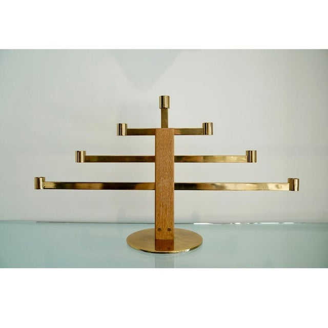 This is an oak & brass 1950s Candelabra manufactured by AB Markaryd Sweden (# L-54 ).