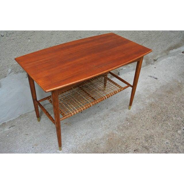 A Two-Tier Table in Teak w. Wicker shelve by Folke Ohlsson for Dux.