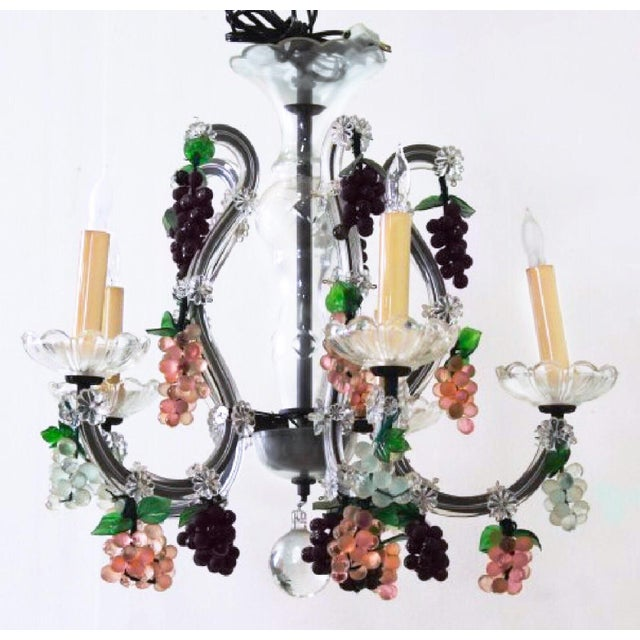 Fresh, lush, gorgeous, familiar , this Venetian art glass / murano chandelier is so traditional that it comes full circle...