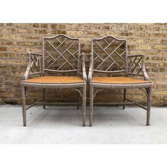Offered is a pair of cane seat bamboo style armchairs. This vintage set would look beautiful flanking a mirror and console...