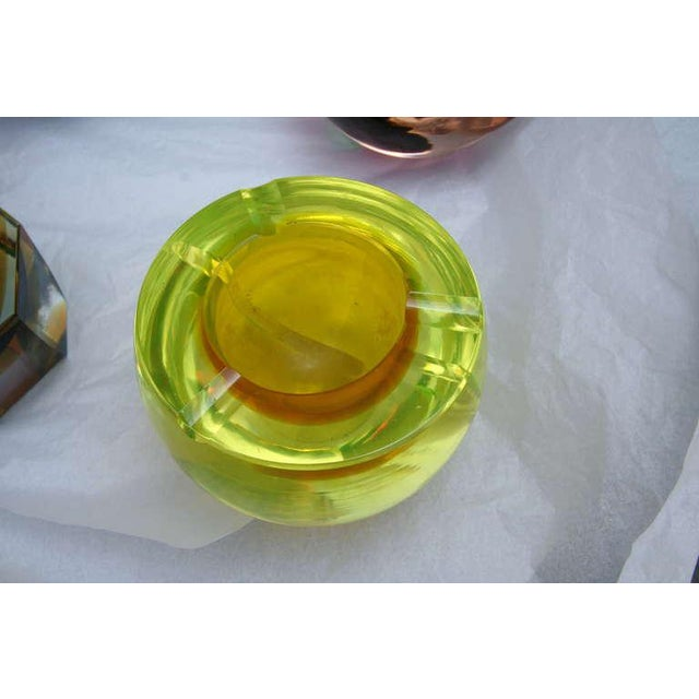 Set of 14 colorful Murano glass pieces (vases and ashtrays) (Prices vary according to piece) Priced individually.