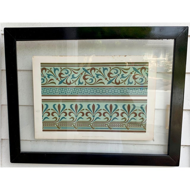 Blue paper print with colored engravings in glass frame. Original plates by Oven Jones from the 1800s.