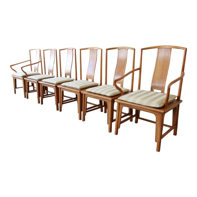 Offering an outstanding set of six Chinoiserie Ming style dining chairs by Baker Furniture. The set includes two captain...