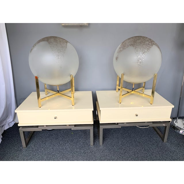 Pair of white ivory Lacquered wood side end or nightstands tables, metal Chrome by Mario Sabot. Famous manufacture like...