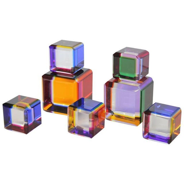 "Collection of five Lucite cubes by Vasa Velizar Mihich. Large cube 3.25"" by 3.25"". Small cube 2"" by 2""."
