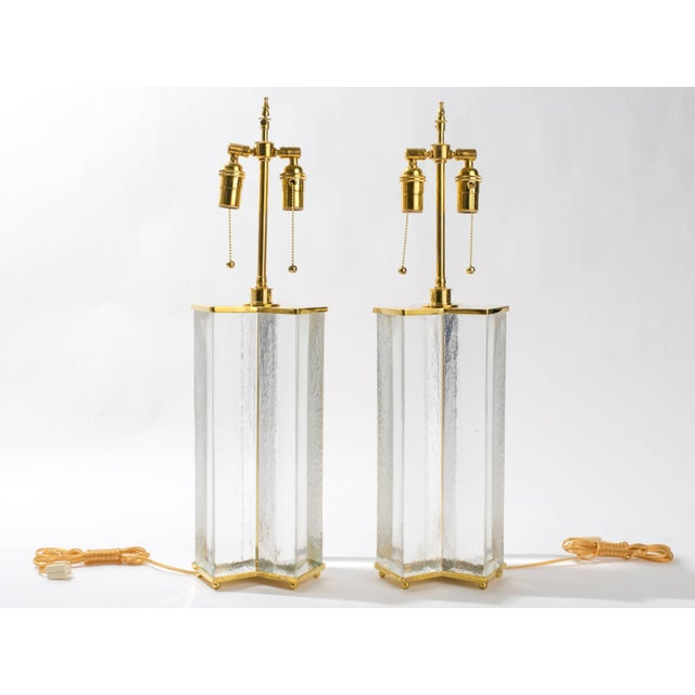 Solid clear glass and brass table lamps. Double pull chain sockets with adjustable height.