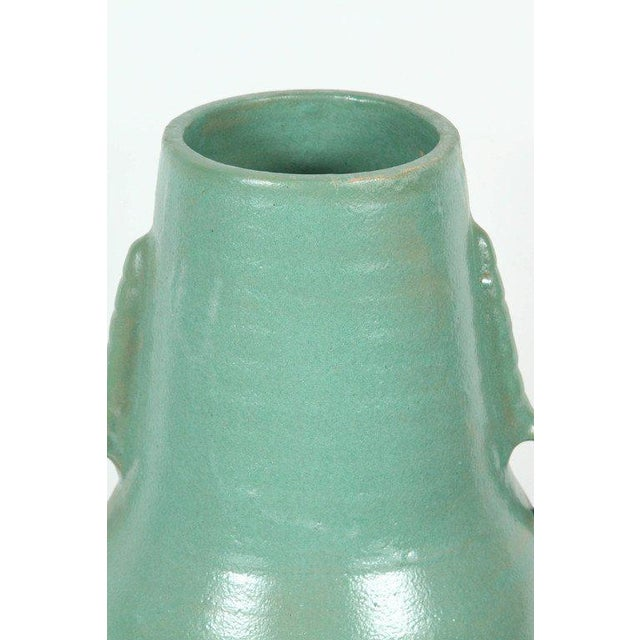 Pair of footed Moroccan turquoise teal color handcrafted ceramic vases with handle. Size: 22 in H. 12 in Diameter for the...