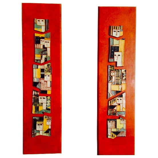 A great strong modernist design pair of ceramic plaques mounted on finished wood plaques created by Harris Strong the...