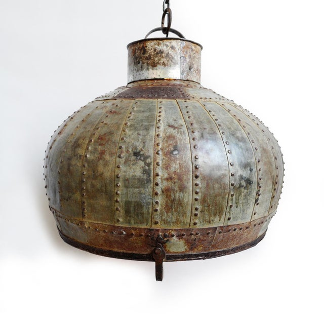 Industrial iron rivet lantern. Each is unique with iron mixed coloring and rustic finish. Includes rustic old chain for...