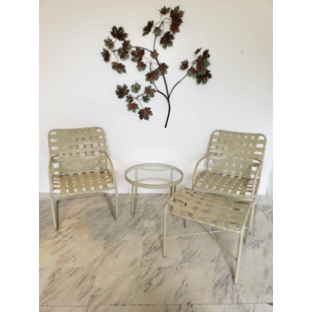 Mid-Century Modern brown Jordan pair of bouncy rocking armchairs, ottoman and side/end table. This set is built well and...