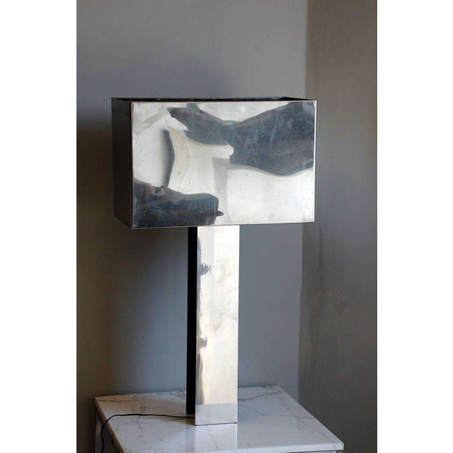 Sculptural 1970s chrome table lamp by Curtis Jere. Signed C. Jere 76 inside the shade.