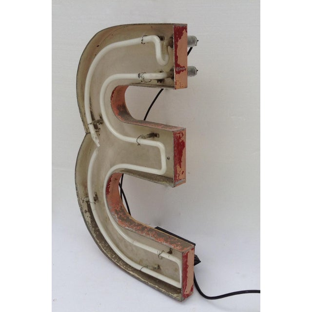 "Vintage; Neon letter, ""E,"" sign from an original neon sign, that spelled out the word, ""Diner."" Taken form an old rail car..."