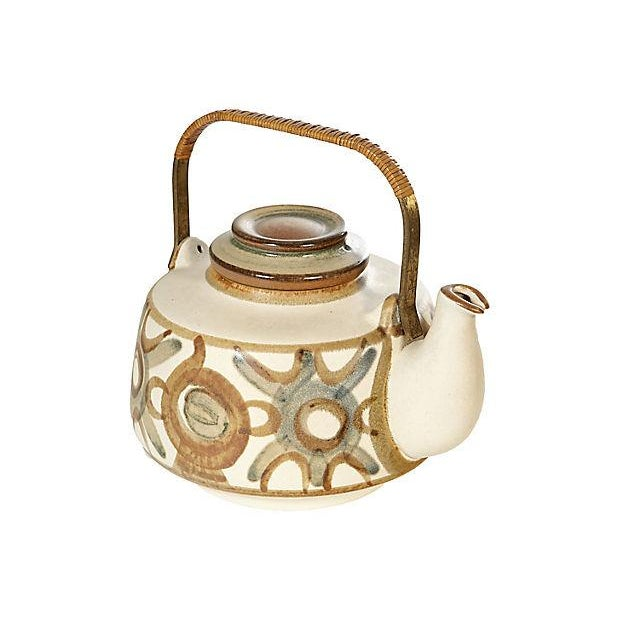 Hand-painted teapot designed by Noomi Backhausen for Søholm Denmark, circa 1970. The teapot has a metal handle with a...