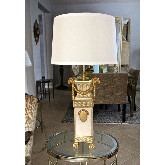 French Directoire 19th century carved 23k water gilt finish and partial painted wood table lamp. Expertly crafted...