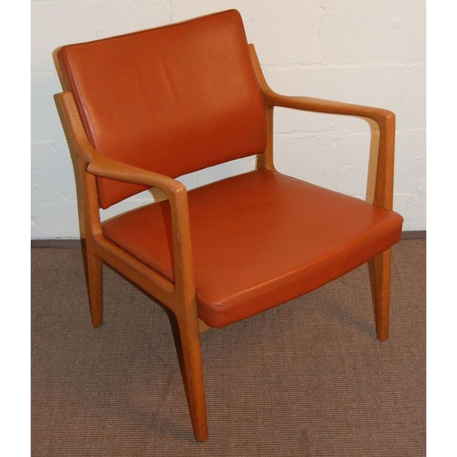 This stunning teak arm chair was designed by Karl-Erik Ekselius for JOC Mobler, Vetlanda, Sweden. In original dark pumpkin...