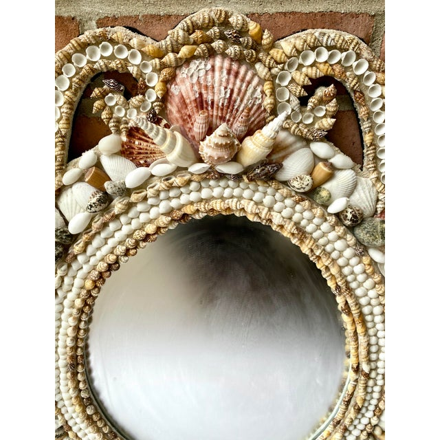 Bring a Hollywood Regency beach vibe into your home with this fabulous vintage shell encrusted mirror! Ready to hang.