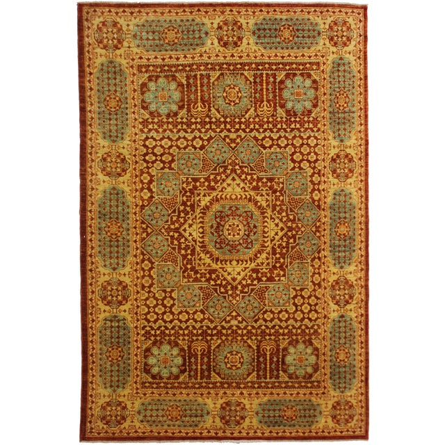 This stunning Mamlok Rug was hand knotted with 75% wool and 25% cotton dyed with natural color. This piece has very tied...