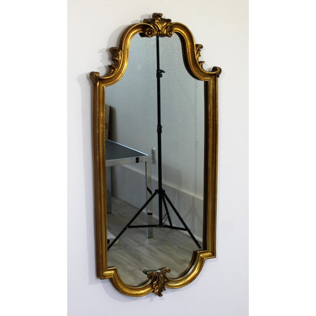 For your consideration is a glamorous, gold gilt wood wall mirror, possibly by La Barge, circa the 1960s. In very good...