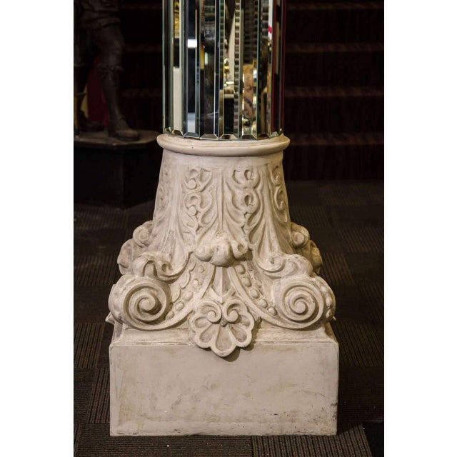 A Fantastic pair of High End monumental mirrored columns with ornately scrolled capitals.Perfect for a Huge Loft that...