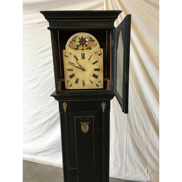 Beautiful Danish empire antique long case clock, with original paint. This clock features a detailed wreath surrounding...