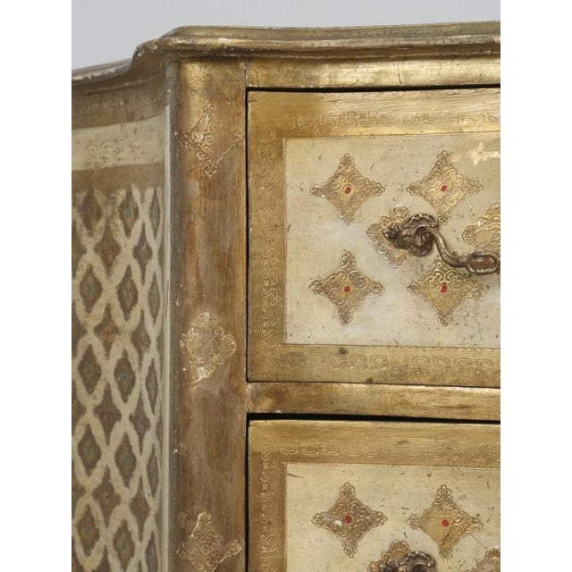 Vintage, painted and gilded commode and it appears to be Italian and most likely post war, or around the 1950s. The...