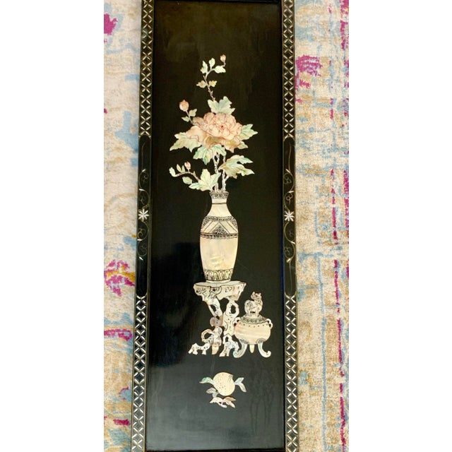 Midcentury Asian chinoiserie lacquered wood wall art with opalescent mother of pearl shell inlay. Gorgeous lotus flower...