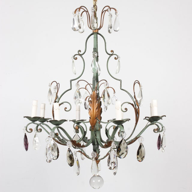 This romantic vintage French iron 8-light chandelier features a whimsical mix of crystal drops in different shapes and...