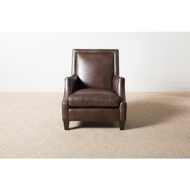 This is an upholstered leather armchair with a solid maple frame and charcoal wood finish. Spoleto Bronze leather 100%...