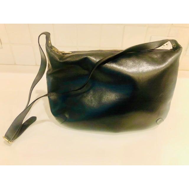 1980s Ferragamo navy leather hobo in calf skin leather. Logo brass hardware. In pristine preowned condition. Long...