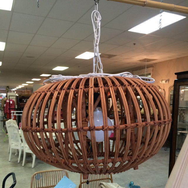 This unique fixture was handmade from a bentwood ottoman. Please note that it is not a ceiling mount; it plugs into an...