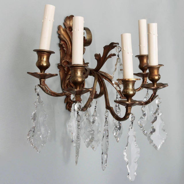 Circa 1900 pair of French bronze metal sconces with acanthus leaf form back plate, five arms with candle style lights and...