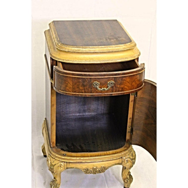 On offer on this occasion is an exquisite antique French Louis XV style commode/nightstand/end table with gold painted...
