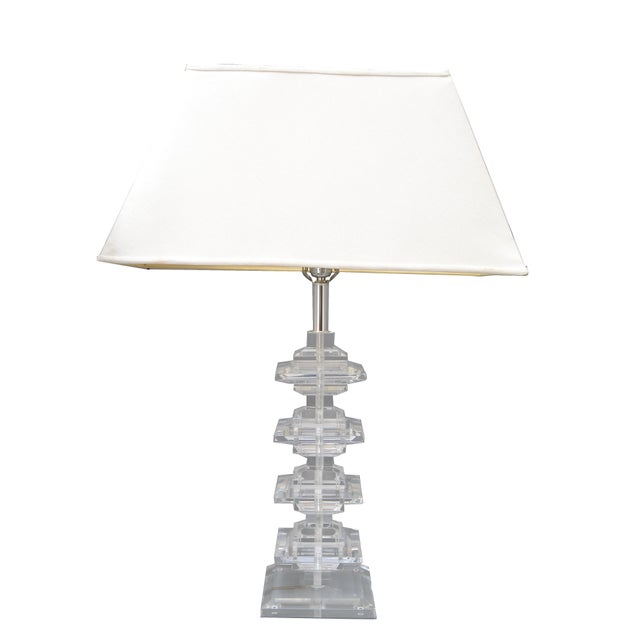 Mid-Century Modern stacked Lucite table lamps. Wired for the U.S. and each uses a max. 60 watts light bulb. No shades.