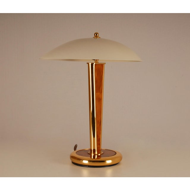 We are Belgium Based Heavy stylized mushroom lamp. Made of brass, burl wood and glass The glass lampshade has an extended...