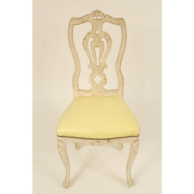 Set of 8 continental painted Louis XV style dining room chairs with creamy yellow vinyl seats, mid 20th century.