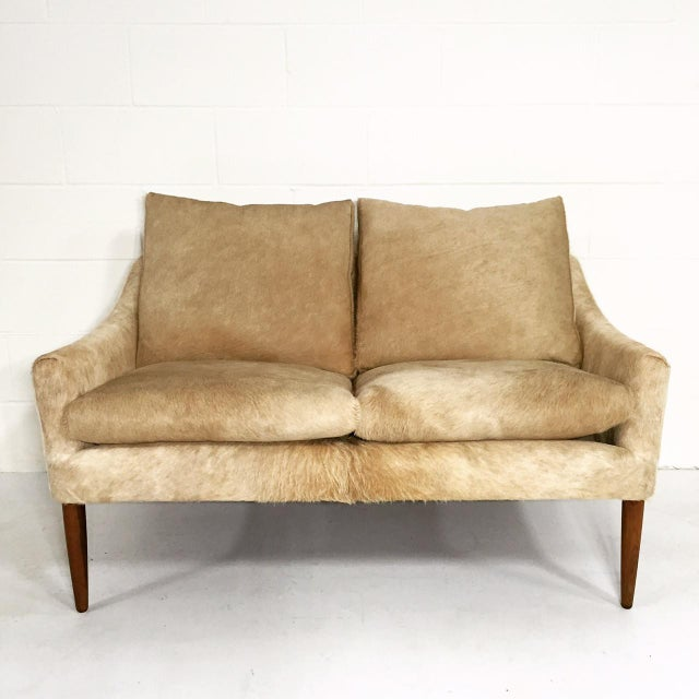 You have to admire every graceful line of this Danish design. We adore this piece! It's a mastery of upholstery. We chose...