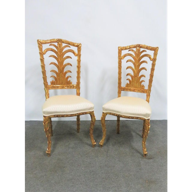 High Quality pair of French gold Gilt leaf carved side chairs.