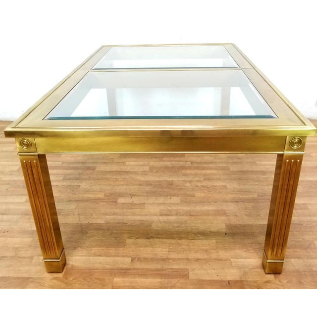 """Stunning brass and glass dining table by Mastercraft, manufactured in the 1970's, the table comes with one 33"""" extension..."""