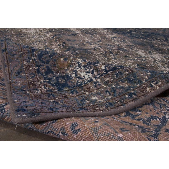 "A vintage hand-knotted overdyed distressed rug with an all-over design. This rug measures: 9'5"" x 12'6""."