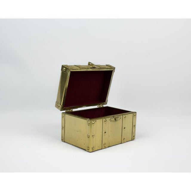 Vintage miniature brass trunk. In the Style of Sarreid. Small/ mini size is perfect for displaying on coffee table or...