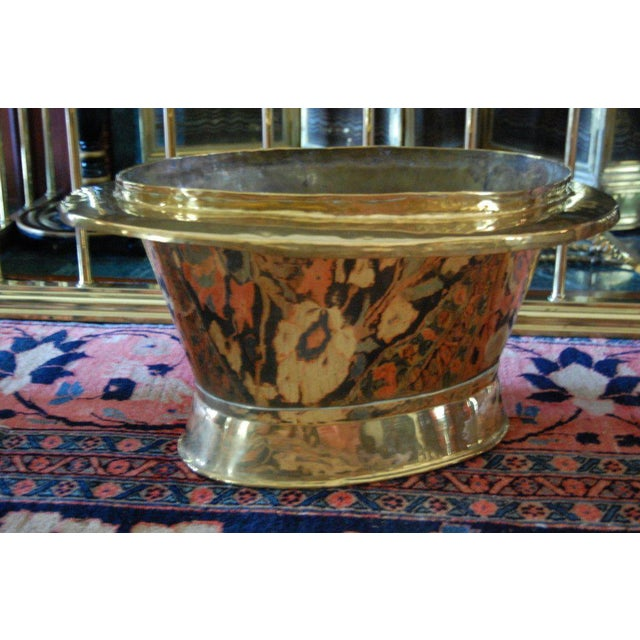 "A large fireside bucket for kindling or coal or a container for fruit or flowers. Interior depth is 9.75"". The brass has a..."