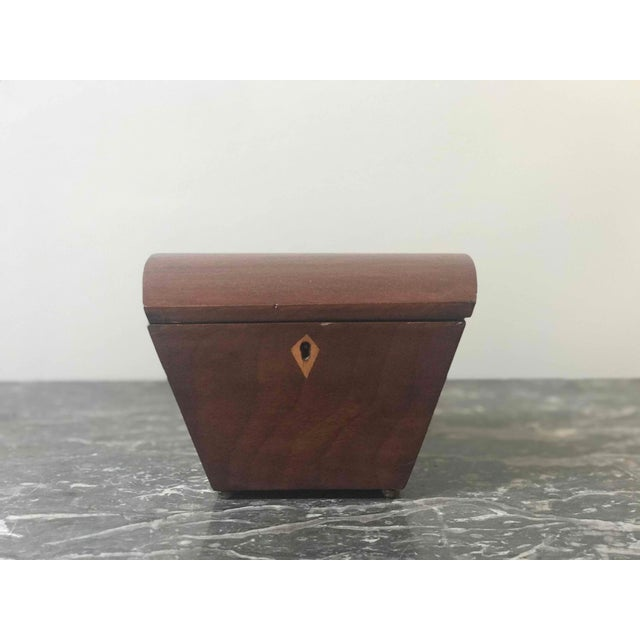 Small tapered tea caddy box from England circa 1840.