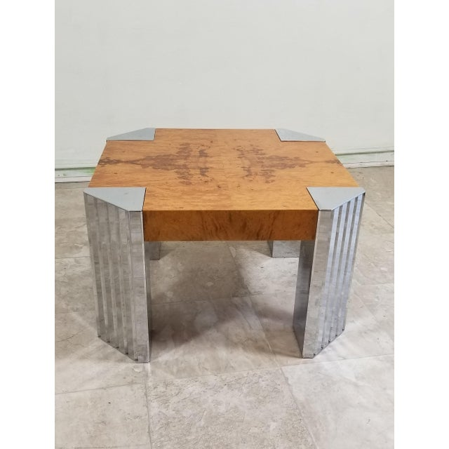 Very attractive coffee table, top is made out of olive ash burl wood Beautiful blond color that makes a nice contrast with...