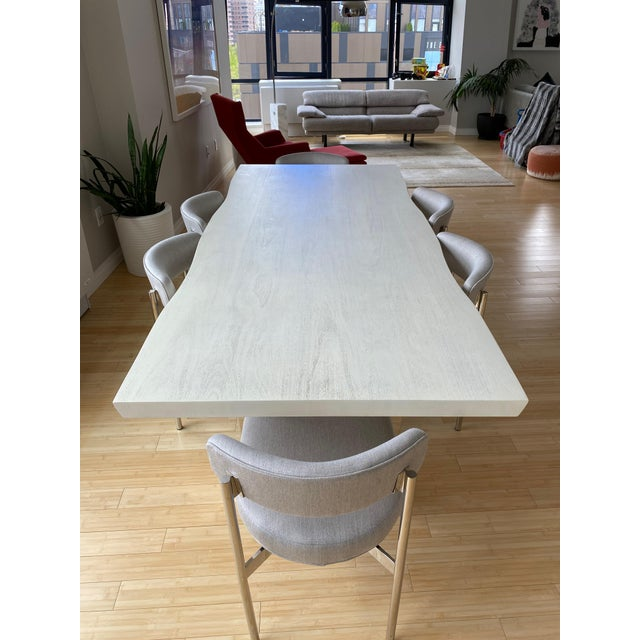 Like New! Mitchell Gold + Bob Williams White Kimora Table with 6 Remy side chairs in terrace pewter Sunbrella fabric. The...