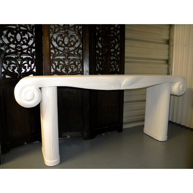 Large neoclassical designer console table, scroll console table with Greco-Roman aesthetic. The table was made by an...